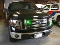 Sterlmar Equipment - Customer personal vehicle - Ford F-150 4x4 pickup truck, with green volunteer fire fighter lighting (Whelen VERTEX and TIR3)